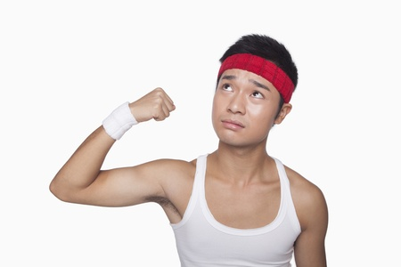 bicep: Skinny athlete showing bicep Stock Photo
