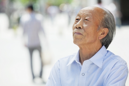 Portrait of smiling senior man, outdoors in Beijing  photo