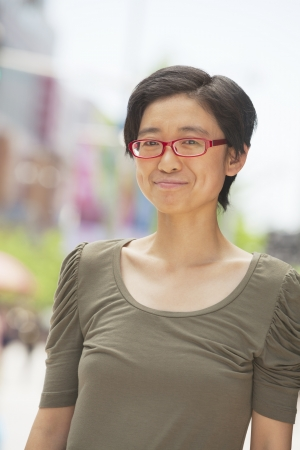 Portrait of shorthaired woman on the street, Beijing