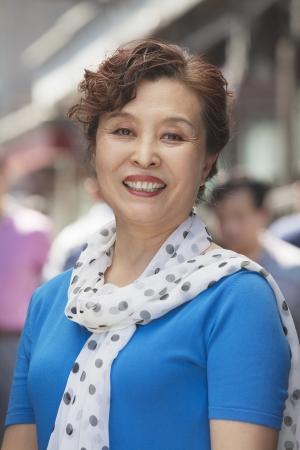 mature women: Portrait of mature women smiling outdoors, Beijing  Stock Photo