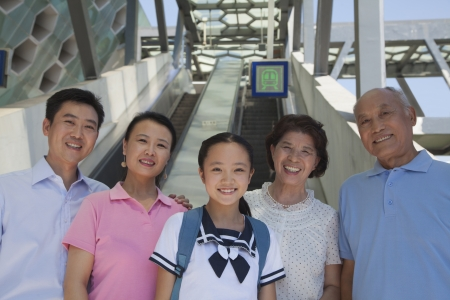 subway station: Family standing next to the escalator near the subway station Stock Photo