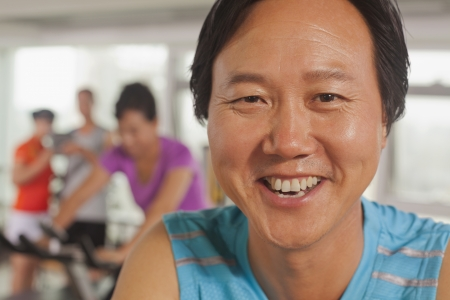 Man smiling and exercising on the exercise bike  photo