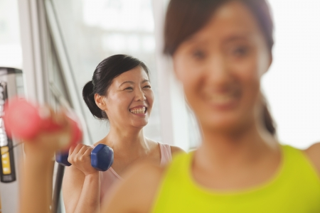 mature women: Mature women lifting weights in the gym