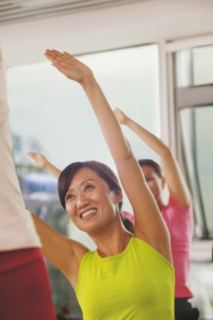 mature women: Mature women exercising in the gym
