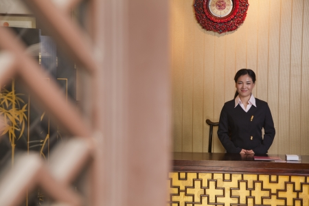 front desk: Receptionist at Hotel Front Desk