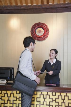 front desk: Businessman at Reception Desk of Hotel