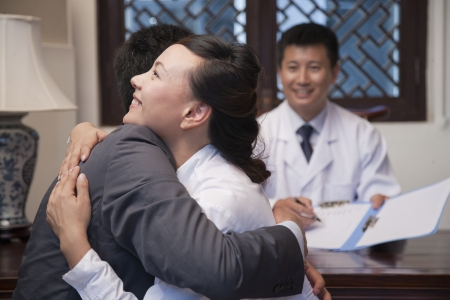 spouse: Patient and Spouse Hug at the Good News