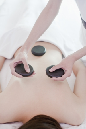 Woman Receiving Hot Stone Massage Stock Photo - 21121689
