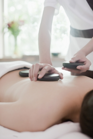 Woman Receiving Hot Stone Massage Stock Photo - 21121690