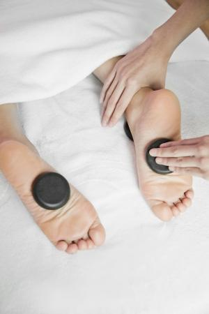 Woman Receiving Hot Stone Foot Massage Stock Photo - 21121694