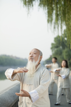 three day beard: Chinese Practicing Tai Ji Stock Photo