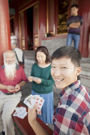 three day beard: Chinese Family Playing Card In Jing Shan Park
