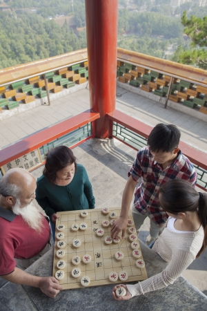 qi: Chinese Family Playing Chinese Chess (Xiang Qi)