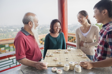 Chinese Family Playing Chinese Chess (Xiang Qi)