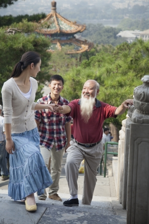 three day beard: Chinese Family Walking In Jing Shan Park