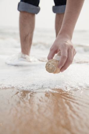 human hand: Close up on hand holding seashell Stock Photo