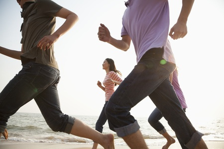 body image: Friends Running at the Beach