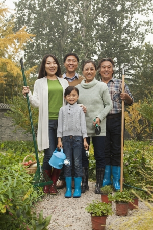 Happy family working in garden photo