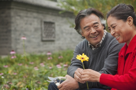 Happy Senior couple with flower photo
