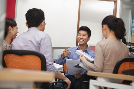 corporate business: Business people having meeting in the office Stock Photo