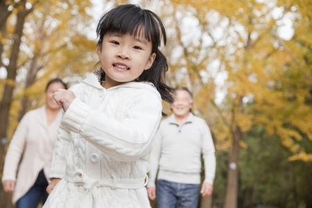 granddaughter: Grandparents and granddaughter in park