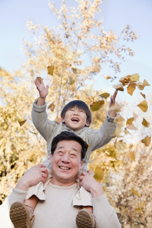 Grandfather and Grandson Playing in the Park