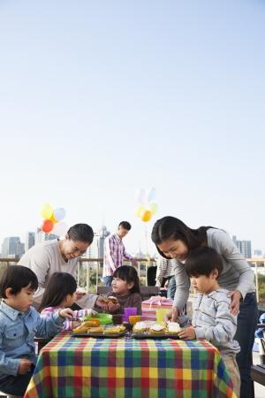 Birthday part, multi-generation family  Stock Photo - 20766633
