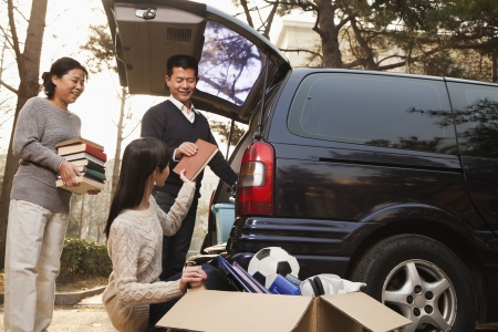 Parents unpacking car for a move to college, Beijing photo