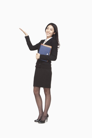 raised hand: Businesswoman carrying files with raised hand