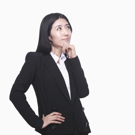 thinking woman: Businesswoman with hand on chin thinking Stock Photo