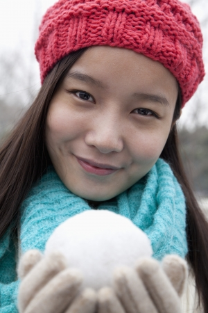 Young Woman with Snowball photo