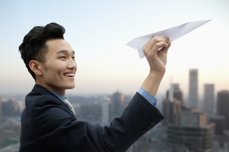 Businessman Flying Paper Airplane photo