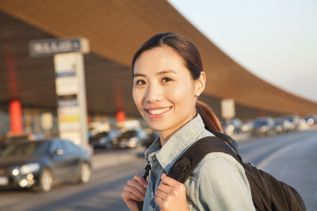 Young traveler portrait outside of airport Stock Photo