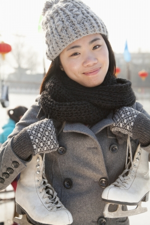 incidental people: Young woman ice skating portrait, Beijing