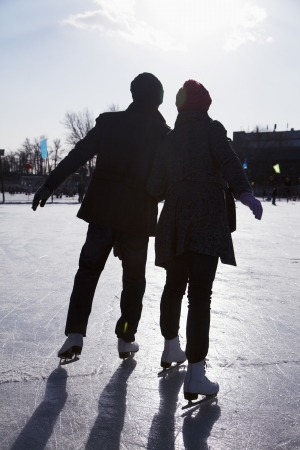 ice skate: Young couple at ice rink Stock Photo