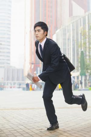 businessman running: Businessman running, Beijing, China
