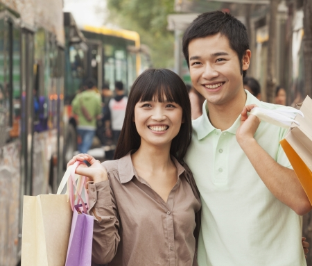 Portrait of smiling young couple at the bus stop, Beijing, China photo