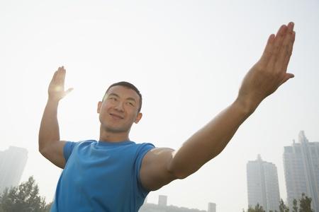 Young Muscular Man Stretching Reklamní fotografie