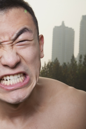 growling: Young Athletic Man Growling Stock Photo