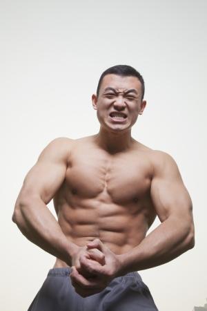 growling: Muscular Man Growling and Flexing Shirtless