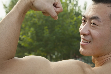 tricep: Man Flexing Muscles Stock Photo