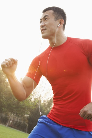 flare up: Muscular Man Running and Listening to Music