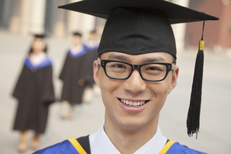 Young Graduate with Glasses Smiling, Portrait Looking at Camera