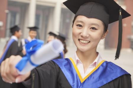 Young Female Graduate Holding Diploma Banco de Imagens