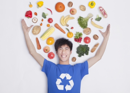 Young man with fresh fruit and vegetables, studio shot Imagens - 35987099