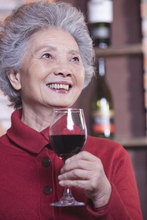 Senior Woman Holding Glass of Wine, Portrait Stok Fotoğraf