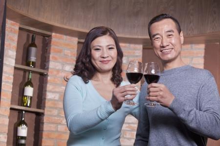 Mature Couple at a Winetasting, Toasting  photo
