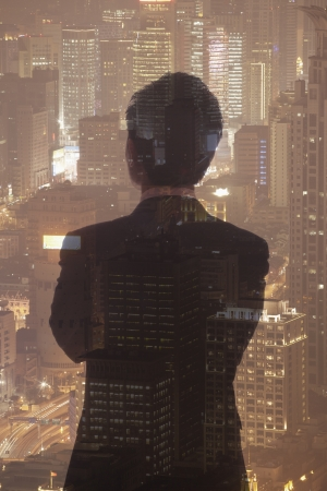 Double exposure of young businessman and the cityscape of Shanghai, China Imagens