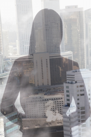multiple ethnicities: Double exposure of young woman over cityscape