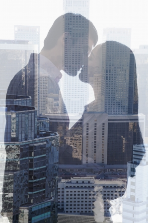 young couple hugging kissing: Double exposure of couple kissing over cityscape
